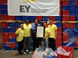 "From left, Angela Milano, Kelvin Keith, Michael Flood, Richard Fong and David Lipschutz with the proclamation from Mayor Eric Garcetti declaring Sept. 27 ""EY Day in Los Angeles."" The five joined more than 170 EY accountants and other professionals who volunteered at the LA Regional Food Bank during ""EY Connect Day."""
